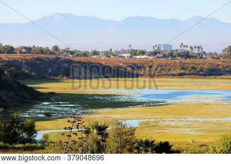 View Of The San Gabriel Mountain Range From A Bluff Surrounded By Wetlands On An Estuary Taken At Ne
