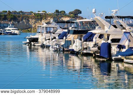 July 31, 2020 In Newport Beach, Ca:  Luxury Yachts Docked At The Newport Bay Surrounded By An Estuar