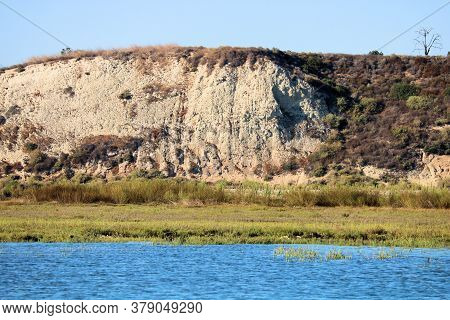 Sandstone Bluffs Surrounded By Tallgrass And An Estuary Taken On Wetlands At Newport Back Bay In New