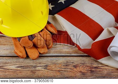 Construction Yellow Helmet And Leather Gloves On Happy Labor Day Usa A Federal Holiday Of United Sta