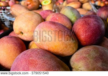 stacks of mango fruits in a basket at traditional marketplace, Taiwan