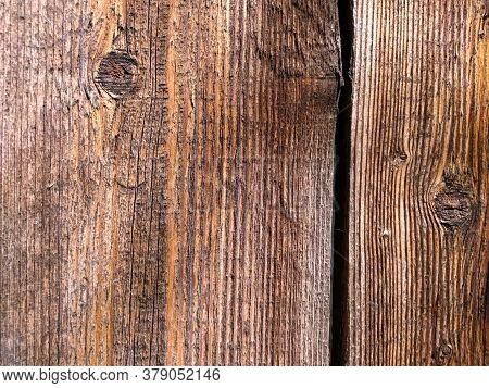 Close-up Teak Wood Textured Background. Vertical Boards With Places Where There Were Knots. Mahogany