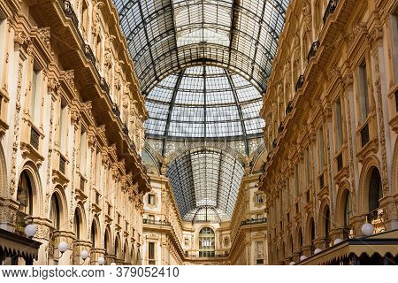 Milan, Italy - April 17, 2018. Galleria Vittorio Emanuele Ii From Inside The Arcade. View Of The Gla