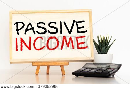 Passive Income Text On Wooden, Business Concept