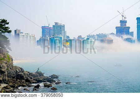 Busan,south Korea - July 20, 2017:  The Famous Haehundae Beach And Bay With Thick Large Mist Blow Fr