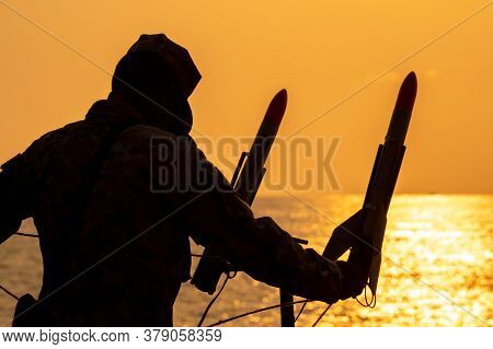 Silhouette Of Navy Sailor Is Going To Shoot Paracute Rocket From The Warship's Deck.