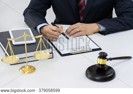 The Private Office Of Asian Young Lawyer Working On Desktop  With Legal Case Document In Workplace F