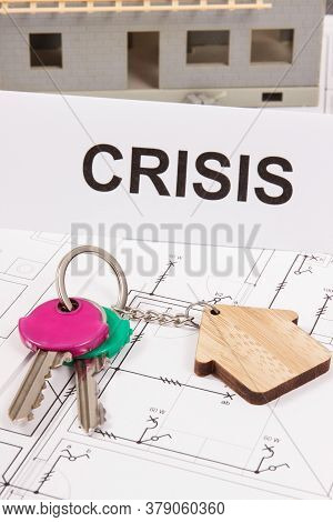 Home Keys And Inscription Crisis On Housing Plan. Concept Of Real Estate Crisis Caused By Coronaviru
