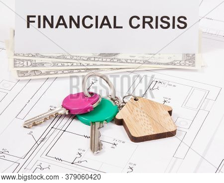 Keys With Home Shape, Currencies Dollar And Inscription Financial Crisis On Electrical Construction