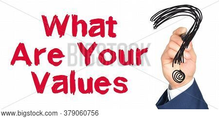 Hand With Marker Writing: What Are Your Values. Hand Of A Businessman With A Marker.