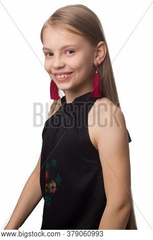 Child Girl With Long Hair. In Black Dress With A Flower Pattern