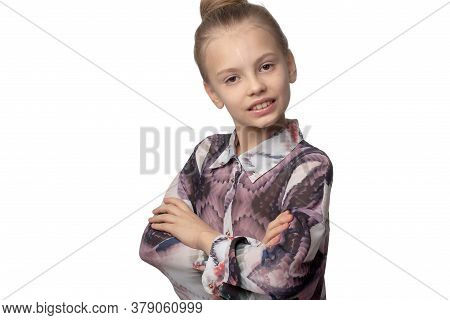 Child-girl With Long Hair Gathered In A Bun