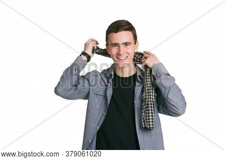 A Young Man In A Manatee Shirt, Black T-shirt And Trousers, Isolated On White
