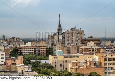 View To City Of Mendoza In Sunset With Dark Clouds And Living Area