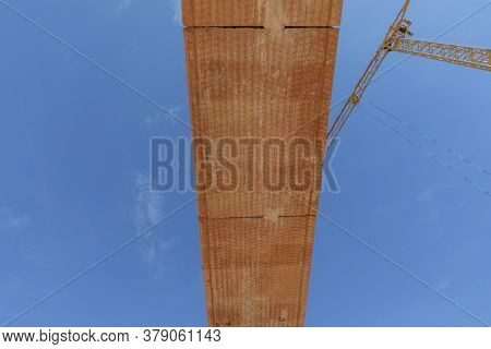 Overthrow With Red Construction Blocks Under Clear Blue Sky With Crane