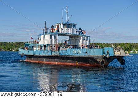Voznesenie, Russia - June 13, 2020: Car And Passenger Ferry Sp-28 On The Svir River Close Up On A Su
