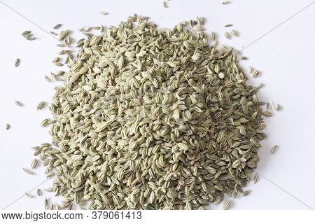 Brown Cumin Seeds Heaped Up  In White Background