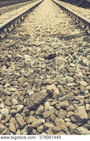 Background With Gravel And Railroad Line. Old Railroad. Toned. Vertical Photo