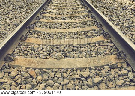 Background With Gravel And Railroad Line. Old Railroad. Toned