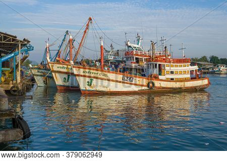 Cha Am, Thailand - December 10, 2018: Fishing Ships At The Pier Of Fishing Port On A Sunny Morning