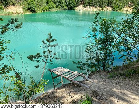 Chalk Quarry Lake With Bright Turquoise Water. Sunny Summer Day Landscape