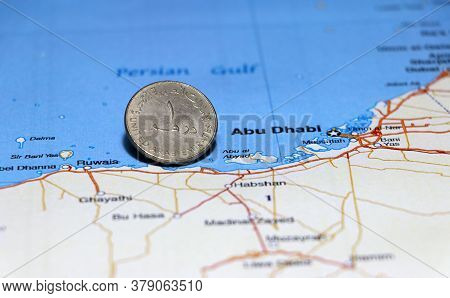 One Coin Of United Arab Emirates One Dirham Money On Obverse Put On The Map Near Abu Dhabi City. Con