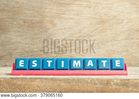 Tile Letter On Red Rack In Word Estimate On Wood Background