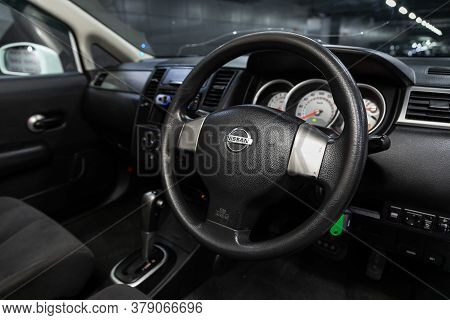 Novosibirsk/ Russia - July 26 2020: Nissan Tiida Latio, Prestige Car Interior With Dashboard, Steeri