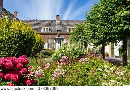 Courtyard With Colroful Garden And Small Houses In The Center Of City Leiden In The Netherlands, Eur