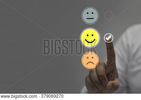 Businessman Pressing Smiley Face Emoticon On Virtual Touch Screen. Customer Service Evaluation Conce