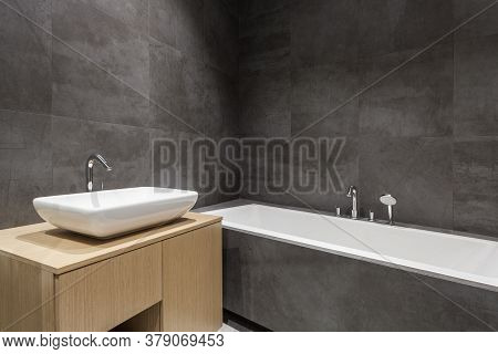 Element Of New And Modern House With Contemporary Interior Design. Bathroom With White Tub And Washb