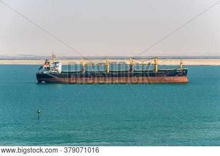 Suez, Egypt - November 14, 2019: Bulk Carrier Vessel Vega Tauru Is At Anchor In Suez Canal In Egypt.