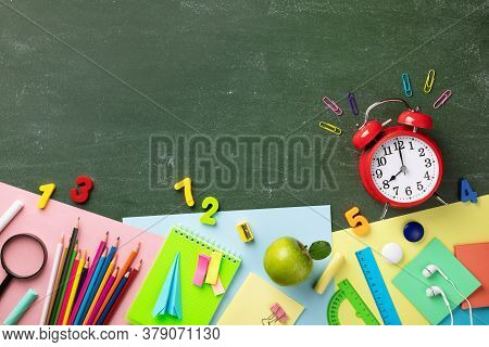 Ringing Alarm Clock, Green Apple And School Supplies On Chalkboard Flat Lay And Top View. Back To Sc