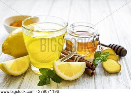 Energy Tonic Drink With Turmeric, Ginger, Lemon And Honey On A White Wooden  Background