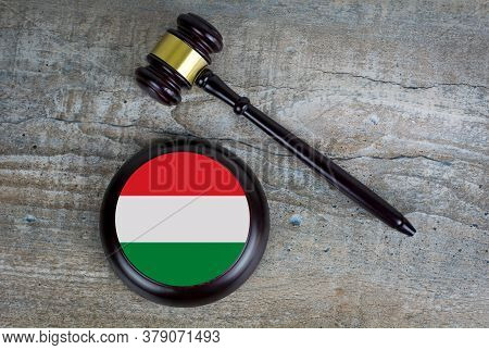 Wooden Judgement Or Auction Mallet With Of Hungary Flag. Conceptual Image.
