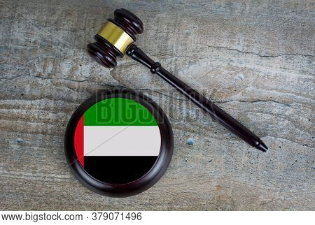 Wooden Judgement Or Auction Mallet With Of United Arab Emirates Flag. Conceptual Image.