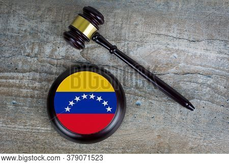 Wooden Judgement Or Auction Mallet With Of Venezuela Flag. Conceptual Image.