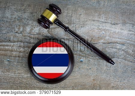 Wooden Judgement Or Auction Mallet With Of Thailand Flag. Conceptual Image.