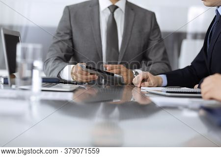 Unknown Businessman Using Tablet Computer And Working Together With His Colleague While Sits At The