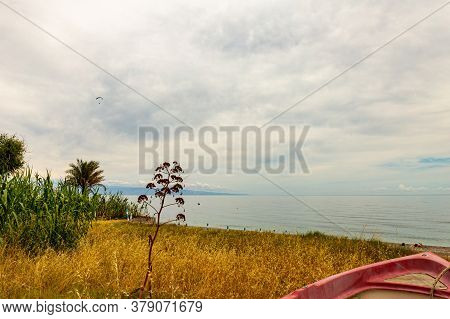 The Sicilian Seaside Clamor On A Spring Day