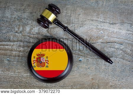 Wooden Judgement Or Auction Mallet With Of Spain Flag. Conceptual Image.