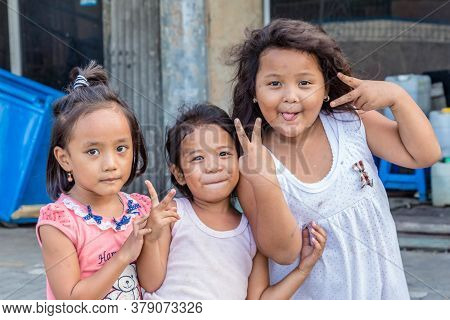 Semarang, Indonesia - October, 31, 2017: Three Indonesian Young Girls Showing The Peace Sign In The