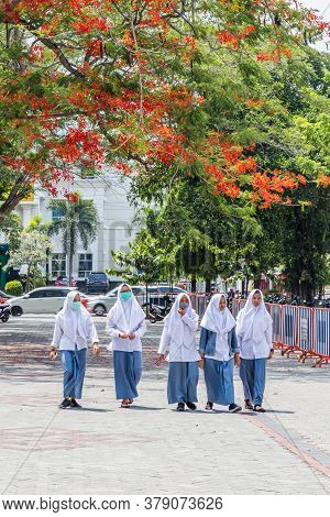Solo, Indonesia - November, 02, 2017 Indonesian School Girls Walking In A Public Park In Solo, Indon
