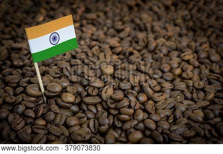 India Flag Sticking In Roasted Coffee Beans. The Concept Of Export And Import Of Coffee
