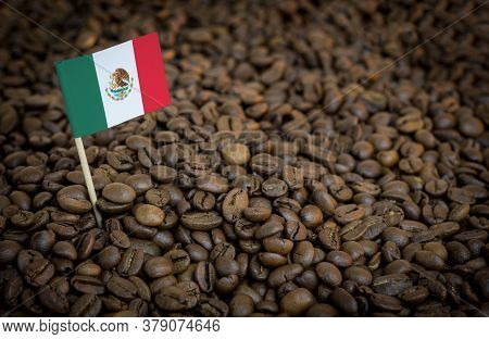 Mexico Flag Sticking In Roasted Coffee Beans. The Concept Of Export And Import Of Coffee