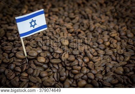 Israel Flag Sticking In Roasted Coffee Beans. The Concept Of Export And Import Of Coffee