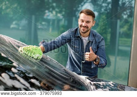 Outdoor Car Wash With Sponge And Foam. Car Washing. Smiling Bearded Man Showing Thumb Up, Cleaning H