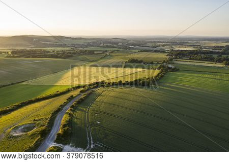 Beautiful Drone Landscape Image Over Lush Green Summer English Countryside During Late Afternoon Lig