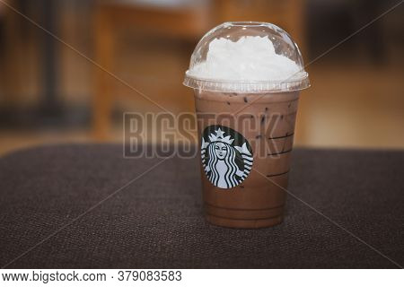 Bangkok, Thailand - August 2, 2020 : Iced Mocha In Takeaway Glass With Whipped Cream On Top From Sta