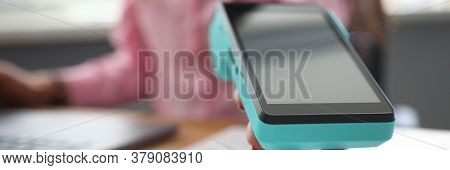 Close-up Of Female Hand Holding Terminal For Repayment. Person Paying Credit Card For Service. Cashl